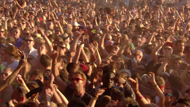 MS PAN Shot of Festival crowd going wild in day / Victoria Park, London, United Kingdom