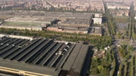 MS AERIAL Shot of Fiat Factory and old factory (Lingotto) in city / Piedmont, France