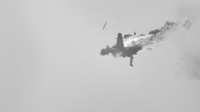 MS Shot of fighter plane being shot down by another fighter plane. War
