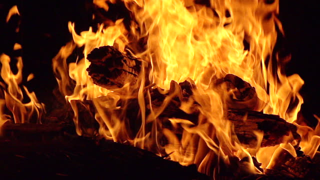CU SLO MO Shot of Fire flames in campfire at campsite / Moremi Reserve, Botswana, South Africa