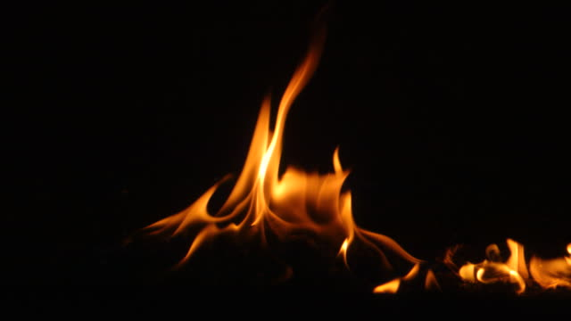 CU SLO MO Shot of fire with embers falling into frame