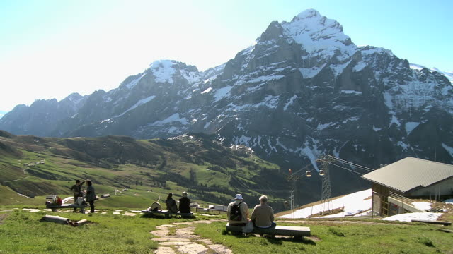 WS Shot of First to Wetterhorn and moving ropeway trolley / Grindelwald, Bernese Oberland, Switzerland