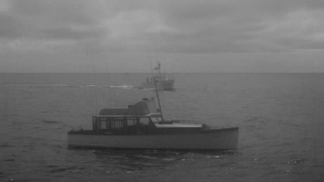 WS Shot of fishing boat and coast guard cutter enters