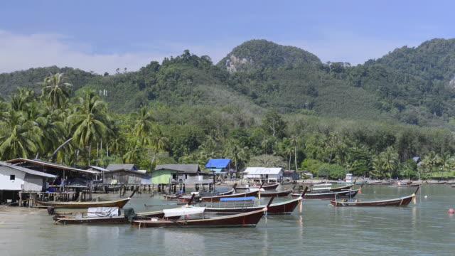 MS Shot of Fishing village and Fishing boats, Hat Chao Mai Marine National Park / Ko Mook, Trang, Thailand