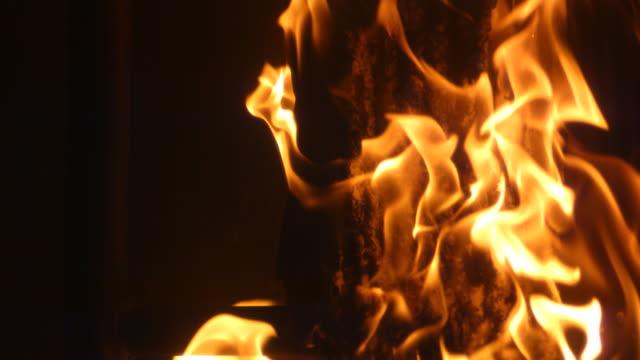 MS SLO MO PAN Shot of flames against black