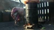 CU Shot of flames under an oil barrel at an open fire outdoors / Durban, South Africa