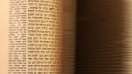 CU Shot of Flipping through pages of Hebrew text / London, United Kingdom