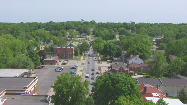 MS AERIAL LA TU Shot of flying over Main Street traffic and stores / Boonville, Missouri, United States