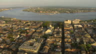 WS AERIAL Shot of flyover french quarter during sunset with Mississippi river / New Orleans, Louisiana, United States