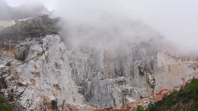WS Shot of fog moving over marble quarry / Colonnata, Tuscany, Italy