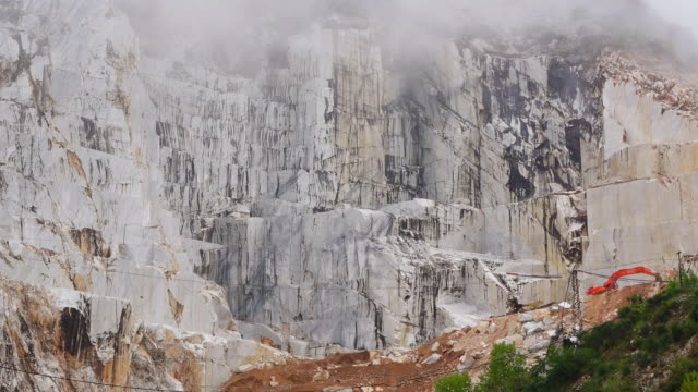 MS Shot of fog moving over marble quarry / Colonnata, Tuscany, Italy
