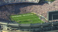 MS AERIAL Shot of football game at Beaver Stadium at Pennsylvania State University with fans in seats / University Park, Pennsylvania, United States
