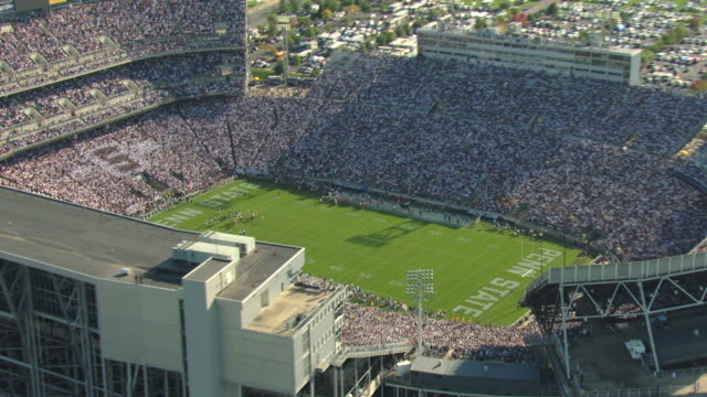 MS AERIAL ZO DS Shot of football players on field during game at Penn State at Pennsylvania State University / University Park, Pennsylvania, United States