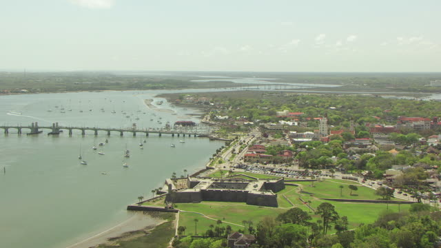 WS AERIAL PAN Shot of fort at Castillo de San Marcos in St Augustine with landscape and buildings around fort close to Matanzas River / St Augustine, Florida United States