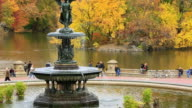 MS TU Shot of fountain and autumn color trees and people from Bethesda Terrace at Lake / New York, United states