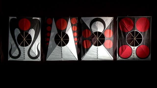 Shot of four kites in black background