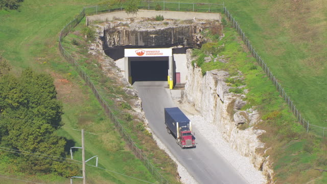 MS AERIAL TS ZO Shot of freight truck exiting Springfield Underground / Springfield, Missouri, United States