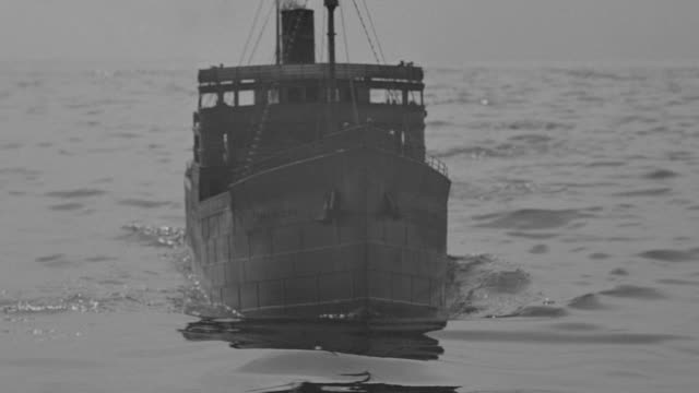 MS Shot of freighter in ocean coming towards