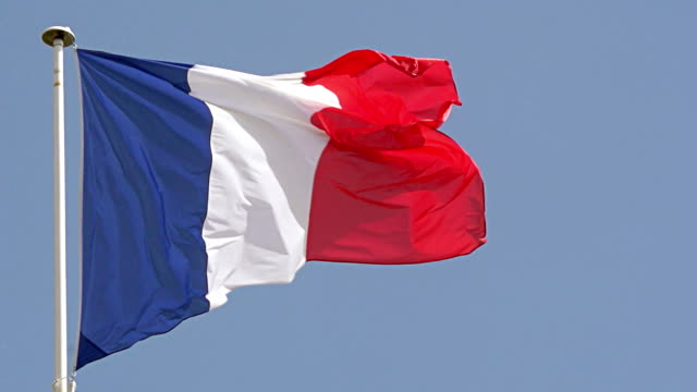 CU SLO MO Shot of French flag waving in Wind / Caen, Normandy, France