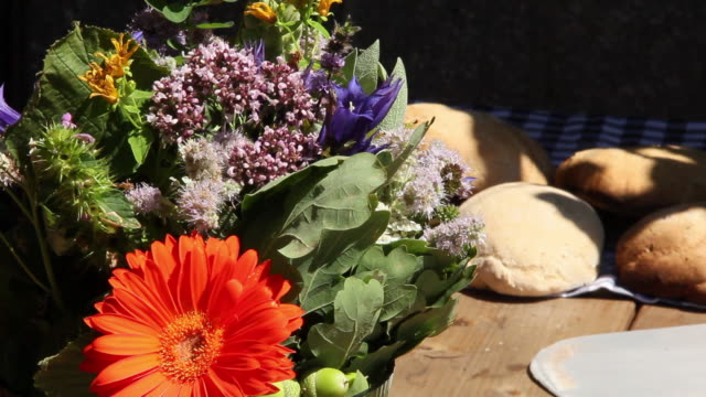 CU Shot of Fresh flowers and fresh bread / Lenggries, Bavaria, Germany