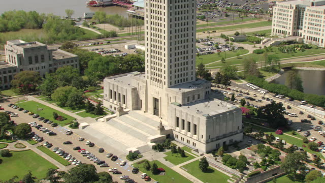 MS AERIAL ZO Shot of front entrance of louisiana state capitol building with Mississippi river / Baton Rouge, Louisiana, United States