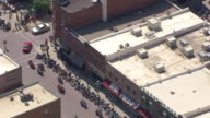 CU AERIAL TS ZO Shot of front of Saloon 10 and people walking and bikes parked in front / Deadwood, South Dakota, United States