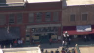 CU AERIAL TS Shot of front of Saloon 10 and people walking and bikes parked in front / Deadwood, South Dakota, United States