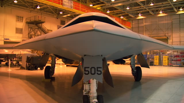 MS Shot of front part of MS X47 aircraft in hangar / Palmdale, California, United States