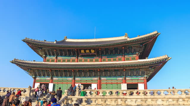 MS POV T/L Shot of Geunjeongjeon Hall with people in Gyeongbokgung Royal Palace (Representative Architecture of Joseon Dynasty) / Seoul, South Korea