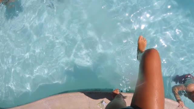 POV shot of girl jumping into pool