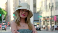 CU Shot of girl looking very calm and confident and wearing hat / Los Angeles, California, United States