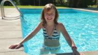 MS Shot of girl smiling in swimming pool / Pollenca Mallorca, Spain