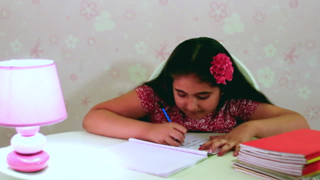 MS Shot of girl writing on notebook / Gurgaon, Haryana, India