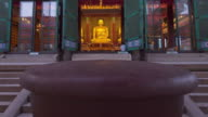 MS T/L TU Shot of Gold Budha Statues in Deawoongjeon of Jogyesa Temple at sunset / Seoul, South Korea