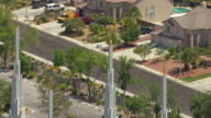 MS AERIAL Shot of gold statues at top of steeple at Church of Jesus Christ of Latter-day Saints church and parking lot / Las Vegas, Nevada, United States