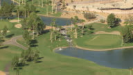 MS AERIAL Shot of golf terrain with green grass and golf course waterfall at Tuscany Golf Club / Henderson, Nevada, United States