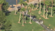 CU AERIAL Shot of golf terrain with green grass and golf course waterfall at Tuscany Golf Club / Henderson, Nevada, United States