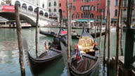 MS Shot of gondolas and ferry's passing sailing in Canal Grande at Rialto Bridge / Venice, Veneto, Italy