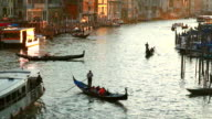 MS Shot of Gondolas on Canal Grande at Rialto bridge at sunset / Venice Veneto Italy