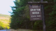 MS Shot of Grafton Notch State Park sign in New England / Newry, Maine, United States