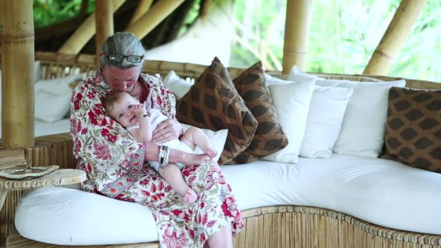 MS Shot of grandmother holding her grandson / Ubud, Bali, Indonesia