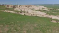 CU AERIAL LA TU Shot of Grass to reveal sandy cliffs at Toadstool Geologic Park / Nebraska, United States