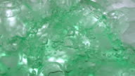 ECU SLO MO Shot of Green liquid pour into glass of ice / Toronto, Ontario, Canada