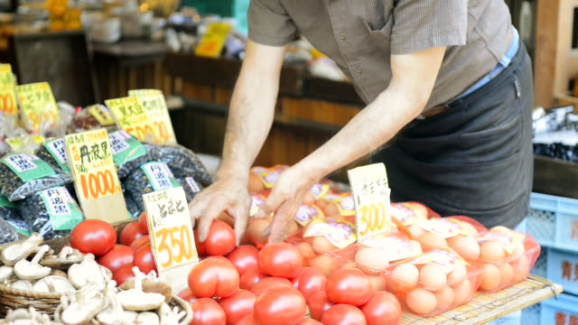 MS TD TU Shot of Greengrocer man is on display in storefront tomatoes / Toyooka, Hyogo, Japan