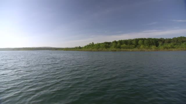 WS POV Shot of Greer's ferry lake site of World Championship Cardboard Boat Race / Heber Springs, Arkansas, United States