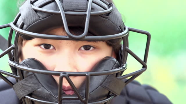 CU SLO MO Shot of Gril wearing catcher's mask / Seoul, South Korea
