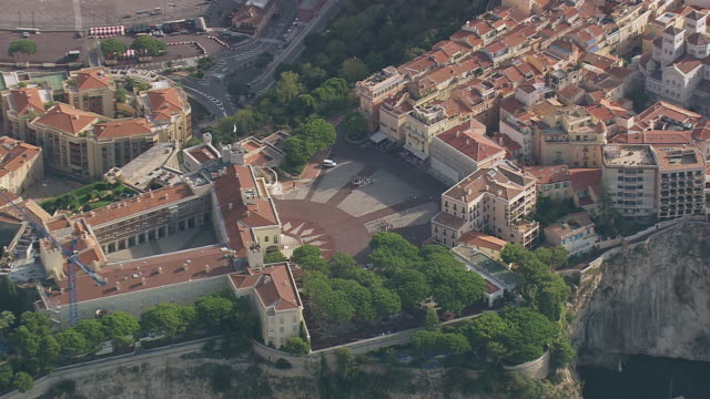 MS AERIAL ZO Shot of Grimaldi Palace to city along with harbor / Monaco, France