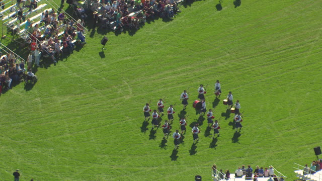 MS AERIAL Shot of group march while playing at scottish irish highland festival / Estes Park, Colorado, United States / Estes Park, Colorado, United States