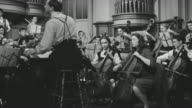 WS PAN Shot of group playing violin in music hall