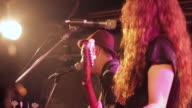 MS Shot of guitarist playing and singing on stage / Shimokitazawa, Tokyo, Japan